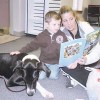 Children read with dogs at Krause Memorial Library during the Reading Rocks reading festival in Rockford.