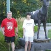 Don Kurylowicz (left), organizer of the second annual Honey Creek Duathlon, and Sean Hogan (right), 15, of Rockford pass Ralph the Moose in downtown Cannonsbur