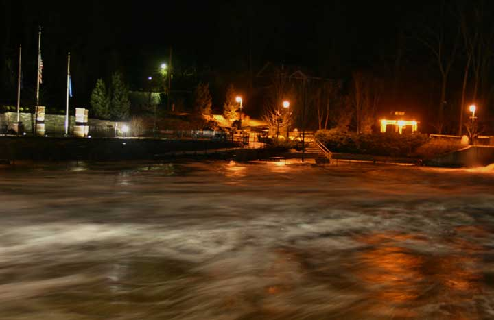 Photo by John Hogan taken beneath the dam Friday evening as the Rogue River crested.