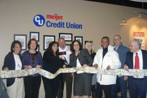 """Plenty of friends were on hand for the ribbon cutting of the new location of the Meijer Credit Union. With representatives from the Rockford Chamber of Commerce, Rockford Public Schools and local businesses, as well as the chance to """"grab"""" cash in the money machine, the event was festive."""