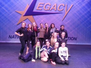Rachel Siegel (back row, left) poses with a group of RDC Competitive dancers at the Legacy National Dance Competition, held in Coopersville April 19-21st.