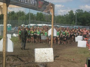 The 43 Dirty Girl Scouts along with the Mudweiser team, which is behind the women, waited to run through the 10,000 volts of Electroshock Therapy together. Photo courtesy of family and friends of the Dirty Girl Scouts.