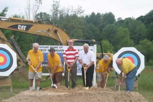 During the groundbreaking ceremony for the West Michigan Archery Center, officials from Plainfield and Algoma Townships took a turn with shovels. Former Plainfield Superintendent Bob Homan, center, now retired, worked toward this project for 18 years, as did others.