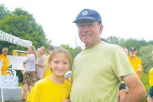 Nichole Scheid, age 11, along with her grandfather, Al Couch, are excitedly waiting for the new archery complex to be ready for use. Scheid, of Grand Rapids, is one of many youth archers who are enthusiastic supporters of the sport.