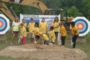 Archers who will enjoy the new Olympic-style facility on Ten Mile Road dig in for the groundbreaking ceremony Monday, July 8. Funding is still being sought for the construction.