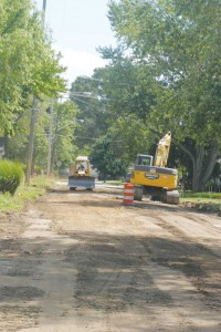 Below, crews work on Elizabeth Street (looking south) on Tuesday, July 23. The street is slated for sidewalks, new sewer and water lines, curbs and gutters and a new surface.