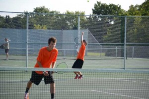 #1 Doubles Thomas Hall serves while Sam Dater waits to crush the return.