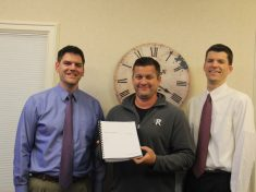 Steve Oosting (left) and Mark Prein (right) stand with Jamie Davies, Rockford's Director of the Department of Public Services. The City of Rockford and Prein & Newhof have partnered in a major, three-year project.