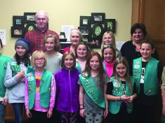 Girl Scout troop 4361 and one Cub Scout from pack 3285 visited Rogue Valley Towers for Holiday Bingo